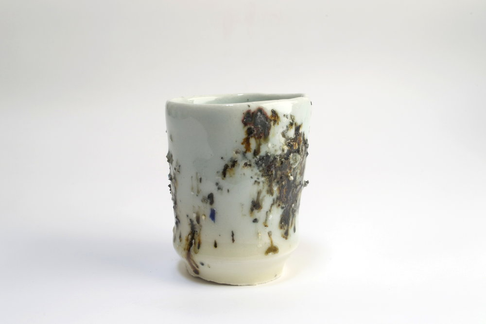 ABOVE: porcelain cup glazed with trash incinerator ash, 2016