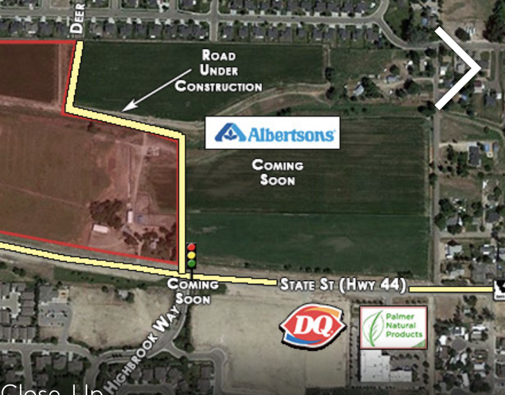 A real estate flyer for an adjacent parcel shows the new store site