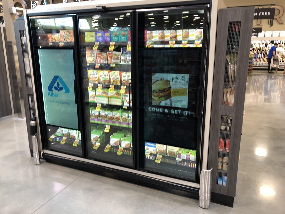 Frozen food freezers with displays built into the door