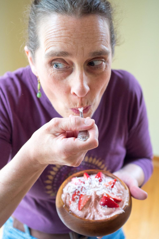 mom & PBJ smoothie bowl mid-bite