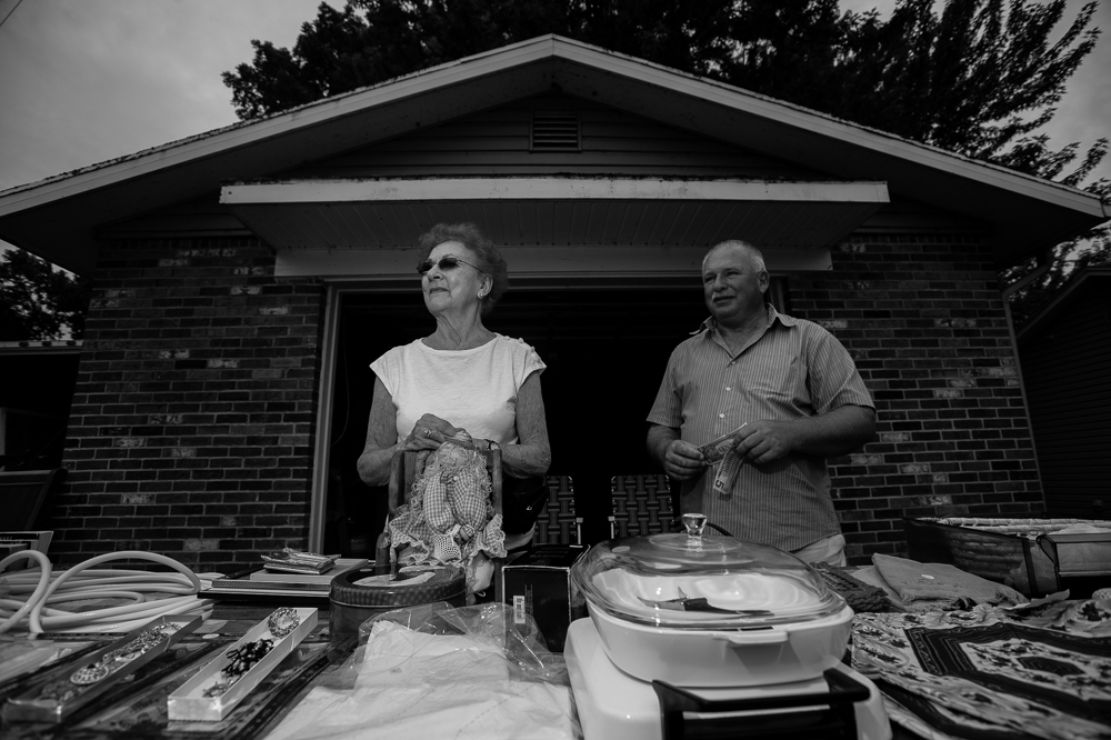 """Aurelius Township residents Joan Taylor and Al Brantley sell goods during the annual """"50 Mile Yard Sale"""", Saturday, July 20, 2016 along Route 90 in the Cayuga Lake region of the Finger Lakes, New York."""