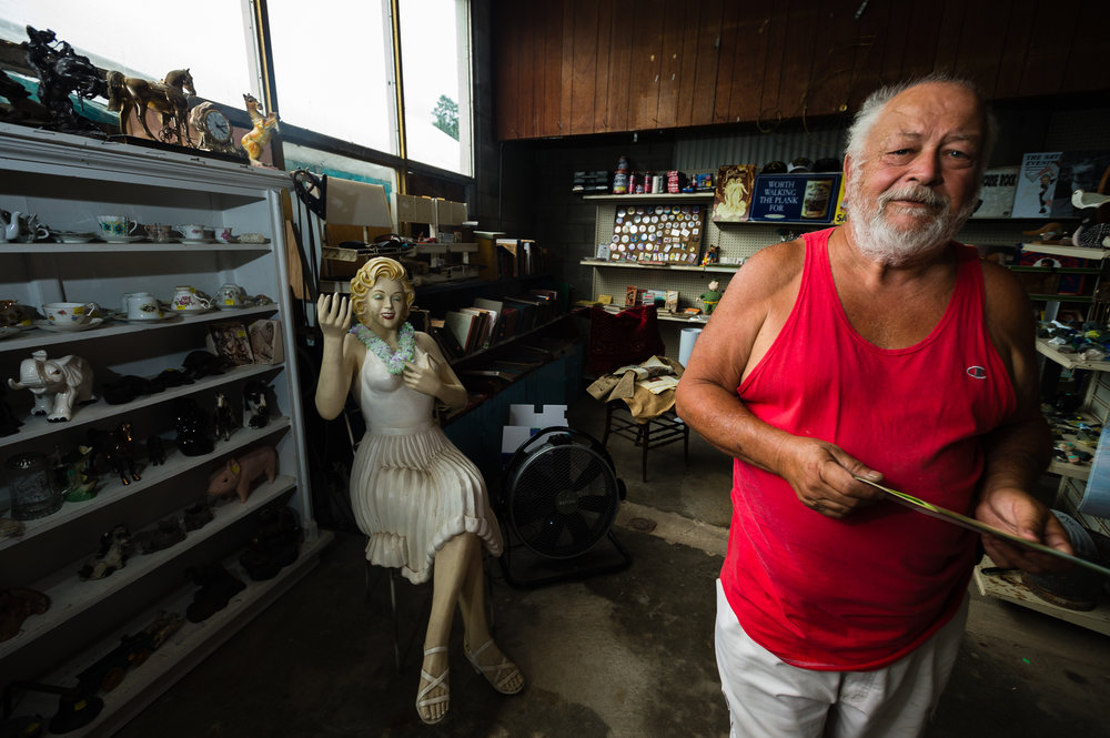 """Cayuga Lake resident Dick Dwello talks about acqusition of his goods for sale during the annual """"50 Mile Yardsale"""", Saturday, July 20, 2016 along Route 90 in the Cayuga Lake region of the Finger Lakes, New York. Mr. Dwello, considered by a handful of other residents as having been around for the beginning of the commiunity event that draws people from as far away as Canada, refers to himself as, """" ... one of the stupid one's who still enjoys it."""""""