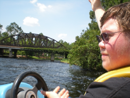My son boating in a personal watercraft on the Sassagoula River, Port Orleans Resorts, Walt Disney World, Florida