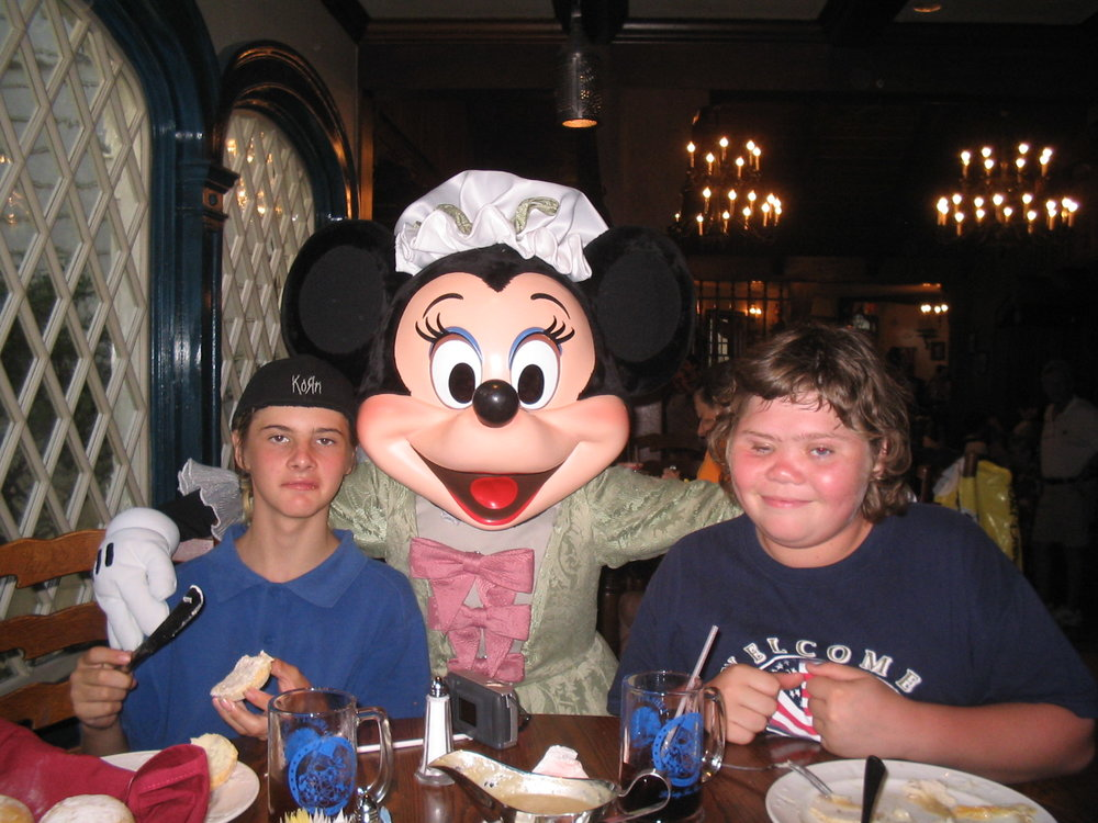 """Who is touching my shoulder?"" My nephew and son when they were teens, with Minnie Mouse - Author's collection"