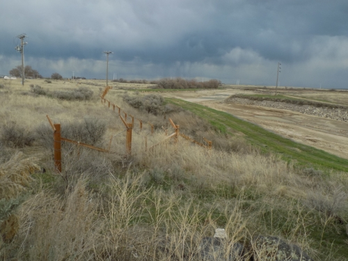 A restored section of the barbed wire fence at Minidoka internment camp
