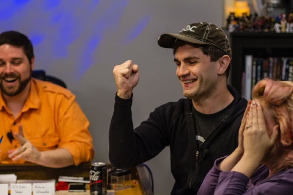 Sam knows his die roll was good enough to succeed, but Elisa sees the twist of negative consequences on the horizon. Left to right: Rodney Thompson, Sam Witwer, Elisa Teague. Photo by John French.