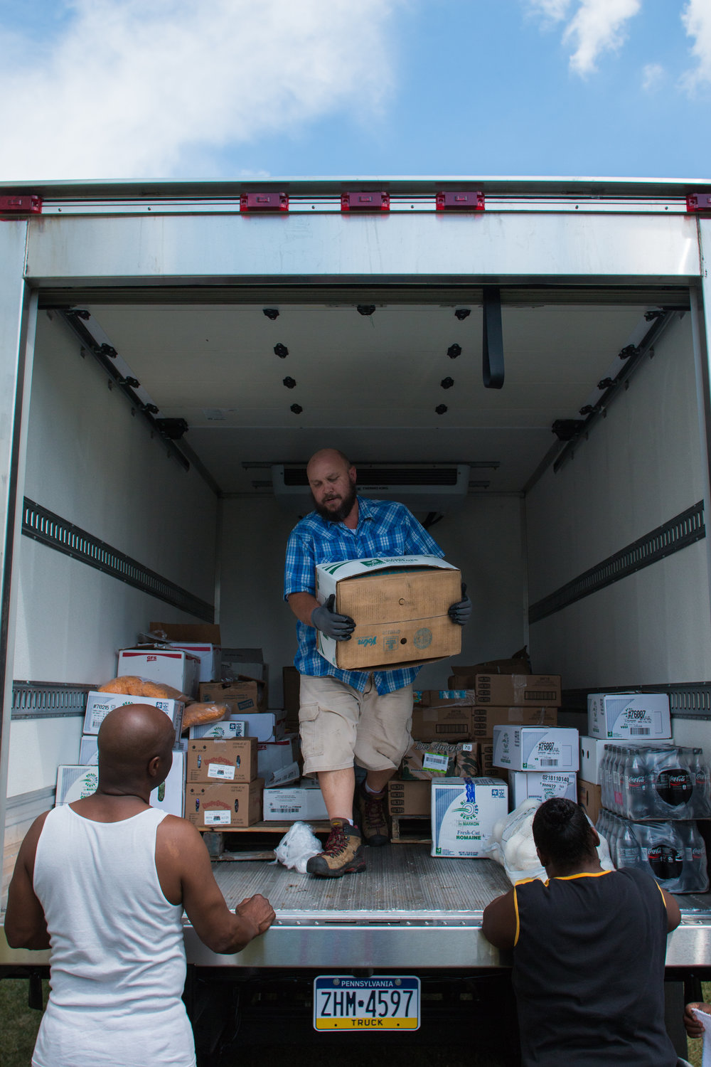 Scott Marshall unloads the truck in McKees Rocks, PA