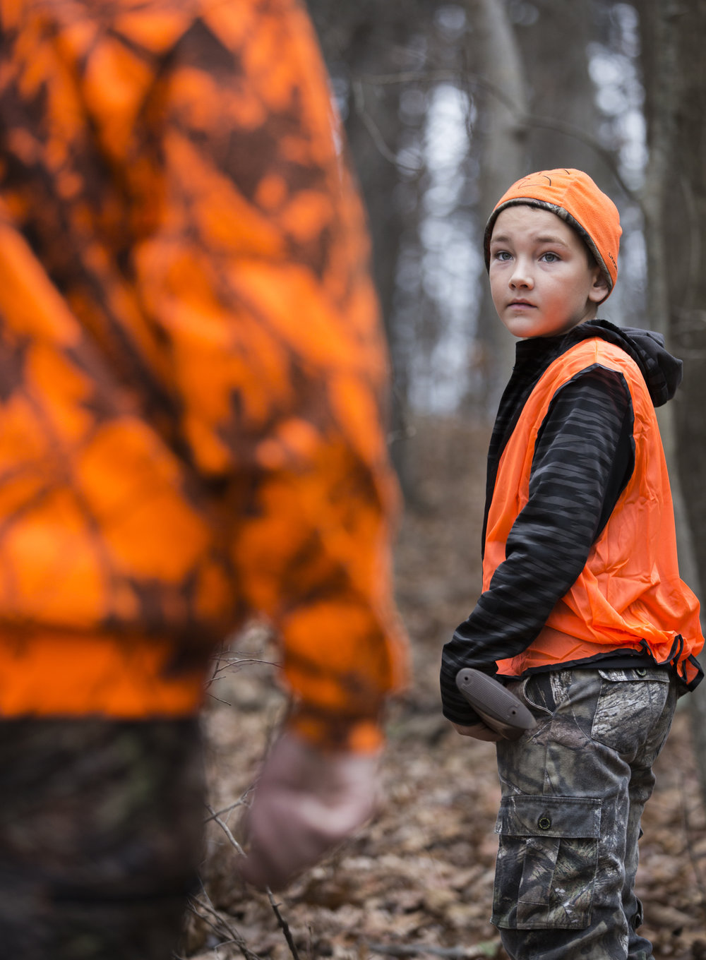 Tristen listens to advice from his father Tom while hunting in Wellston, Ohio, on November 18, 2017. Tom says that Tristen has been joining him on hunts since he could walk.