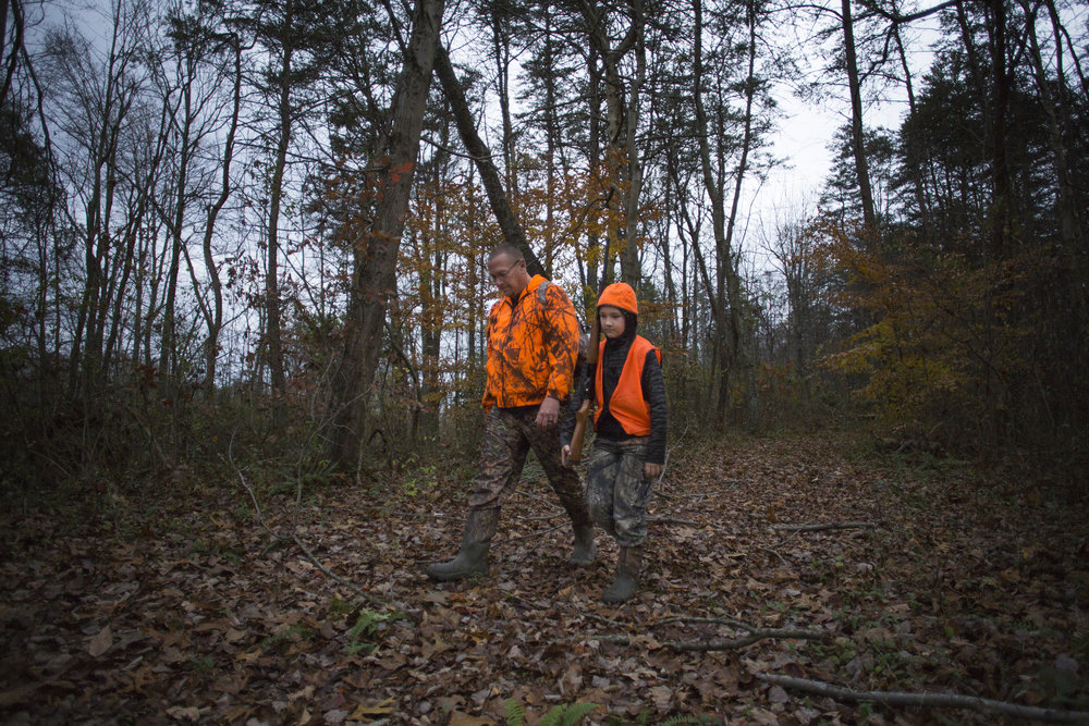 "Tom Denney, left, and Tristen Denney exit the woods after an unsuccesful hunt in Wellston, Ohio, on November 18, 2017. ""there's a lot of heartbreak in hunting,"" said Tom Denney"