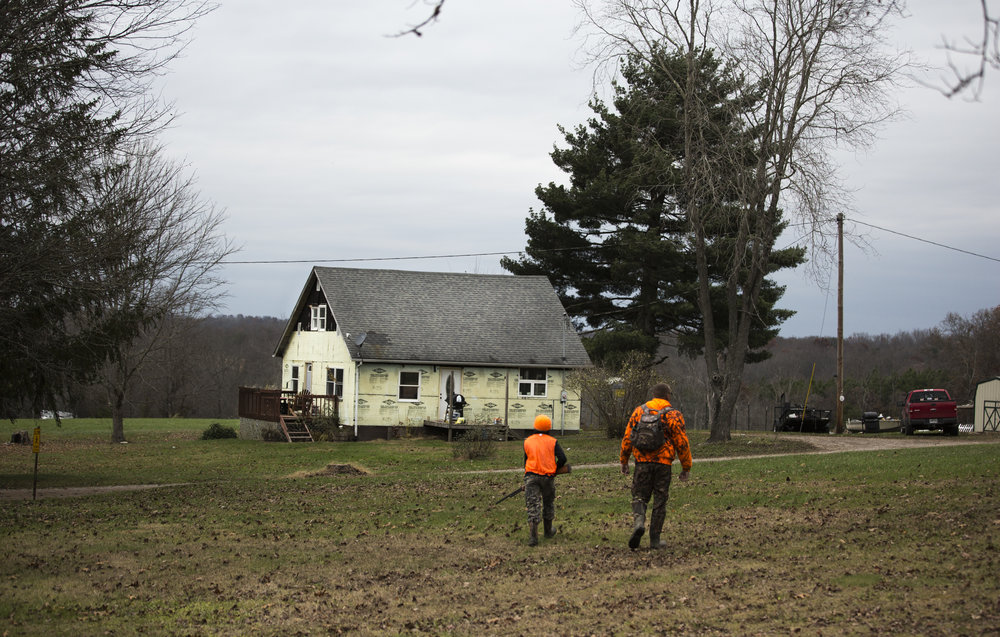 Tristen and Tom return to their hunting camp after an unsuccessful afternoon of hunting in Wellston, Ohio, on November 18, 2017.