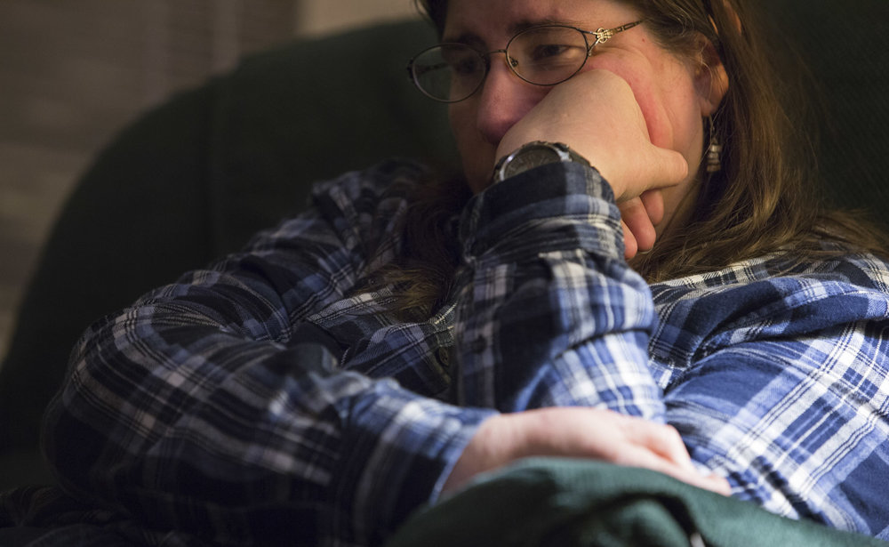 """Christi sits at home during a panic attack. Christi's mood can change dramatically from one moment to the next, and can overcome her at any time or place. According to Christi the only thing she can do is work through them. """"Sometimes you just need to do it by yourself because that's pretty much what you are - is alone,"""" Hysell said."""