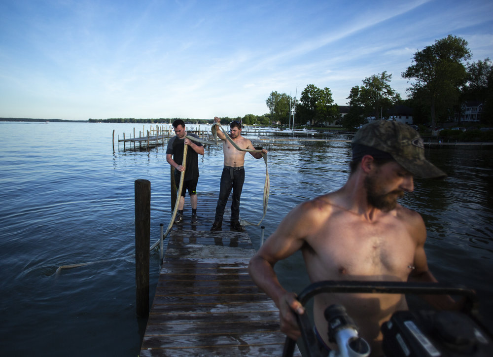 ROCK of WNY employees Michael Hetrick, left to right, Dominick Hetrick and Lewis Millman pack up after assembling a dock,  Friday, June 15, 2018, on Chautauqua Lake in Chautauqua, NY. The entire lake freezes every winter requiring residents to re-assemble their docks at the beginning of every summer.