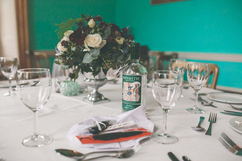 Our beautiful table flowers provided by  Sarah Jane Midwood   and our chefs hat, moustache, and pizza cutter in preparation for our handmade pizzas from  Roslin Catering . Photo courtesy of Olivia Moon Photography
