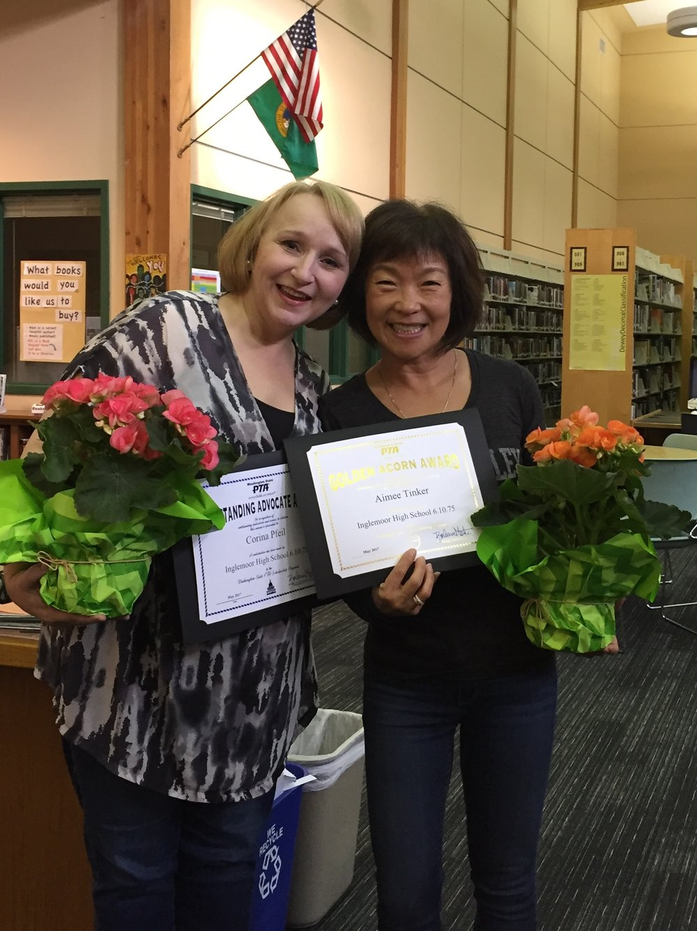 Corina Pfeil (left) is the recipient of the Outstanding Advocate and Aimee Tinker was awarded the Golden Acorn.  A contribution was made to the Washington State PTA Scholarship Fund in honor of all winners.