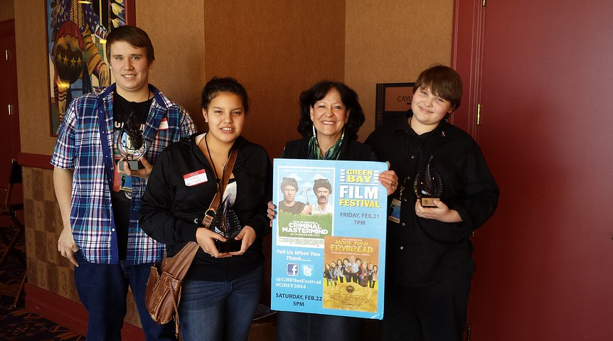 "Ahpahne Thomas (music composer), Shania Jackson (writer/narrator), Patty Loew (mentor), and Jordan Principato (videographer) with their ""Youth Achievement"" awards at the Green Bay Film Festival."