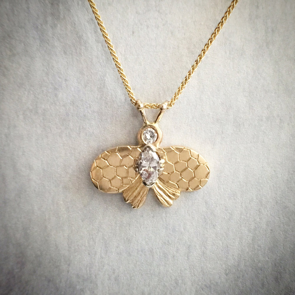 custom bee pendant using heirloom diamond.
