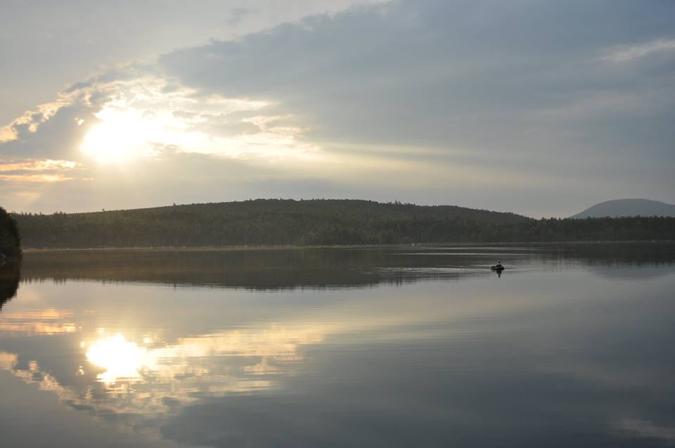 Out in the float tube at sunrise, casting to the subtle but confident rises of feeding brookies in Jo-Mary.