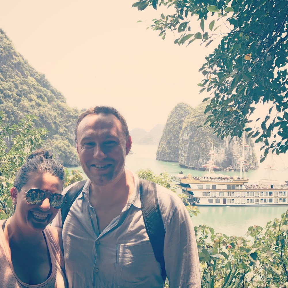 """Nicole and I in Halong Bay -- our tour boat, the """"Dragon Legend"""" in the background"""