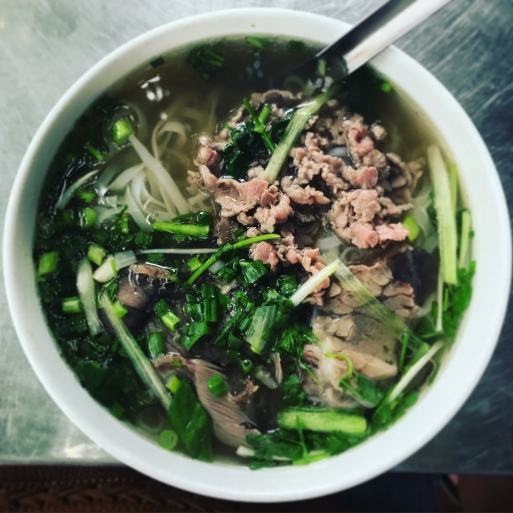 Nicole's first bowl of pho in Vietnam at a roadside spot in Hanoi -- we were intimidated to walk up and order at first but the people working there and eating around us couldn't have been friendlier (even though no one spoke English)