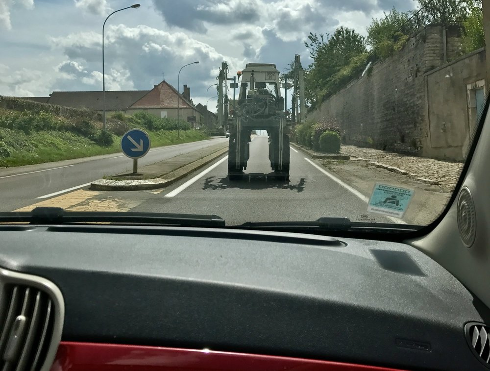 Stuck behind one of the many vineyard tractors -- they are raised in order to drive over the vineyard rows