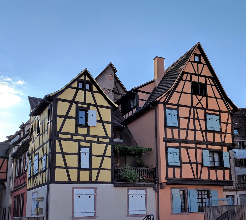 Our Airbnb in Colmar is on the top floor of the orange building on the right (the window without the shutters)