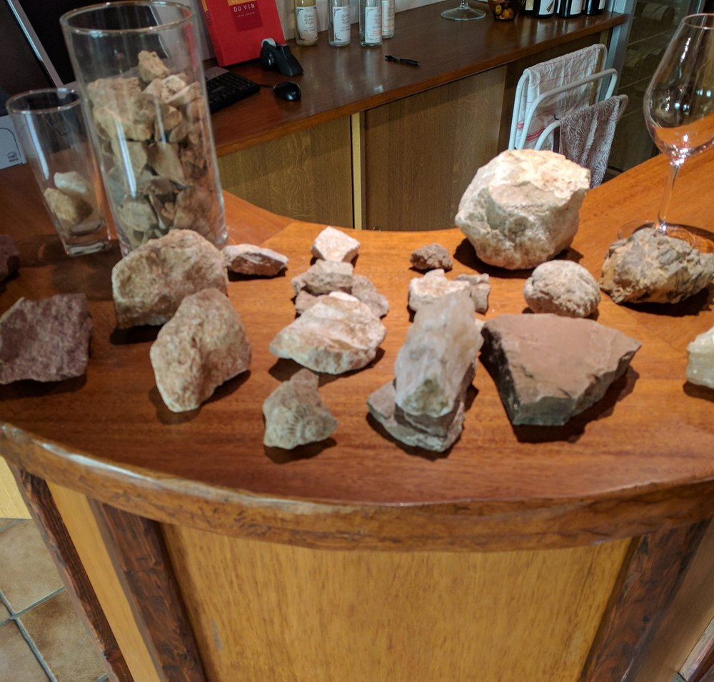 Display of the rocks and minerals found in the soil of the nearby vineyards at Domaine Riefle