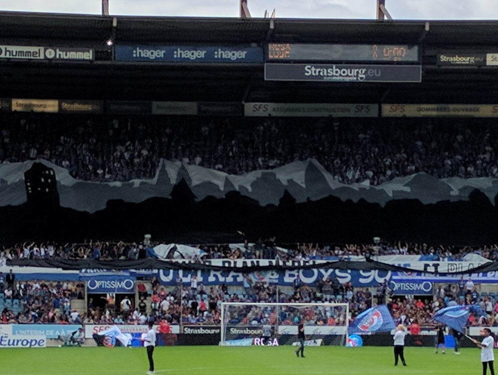 The crowd unfurling a banner of Strasbourg's skyline during the player introductions