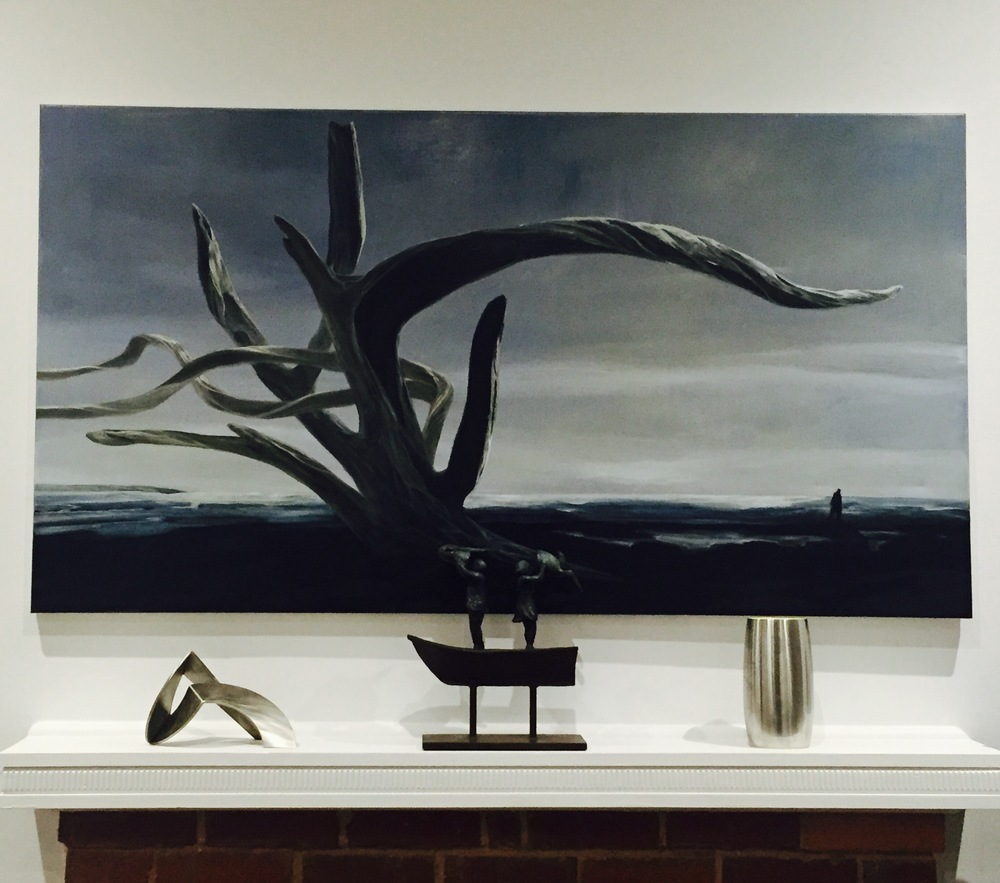 A Graeme Altmann oil painting reminiscent of Warrnambool foreshore, The Passage, sits above the mantle where a Robert Hague sculture on left, entitled Repose II, sits happily next to an Altmann bronze boat named, Rabbit Boat, and a classic Georg Jensen vase.