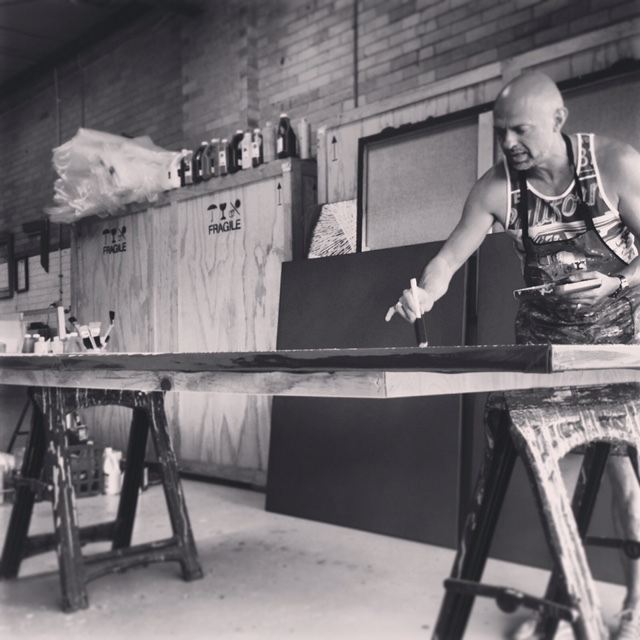 Master painter, Thierry B at work in his Huntingdale studio.