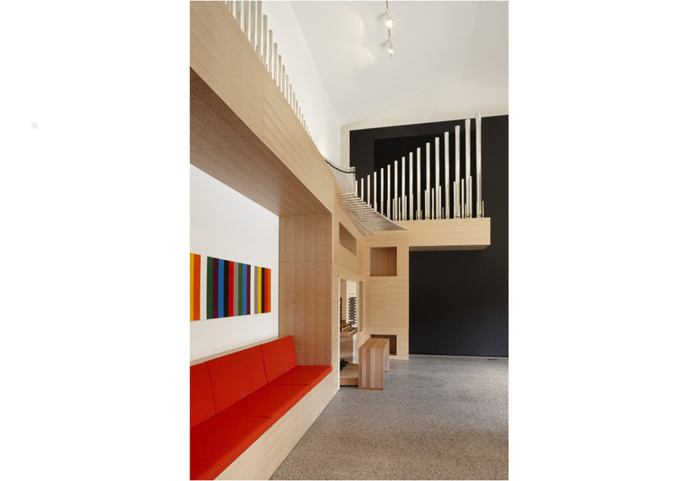 Above:  Lyon also designed a hybrid pipe/digital organ for installation on the west wall of the music room.