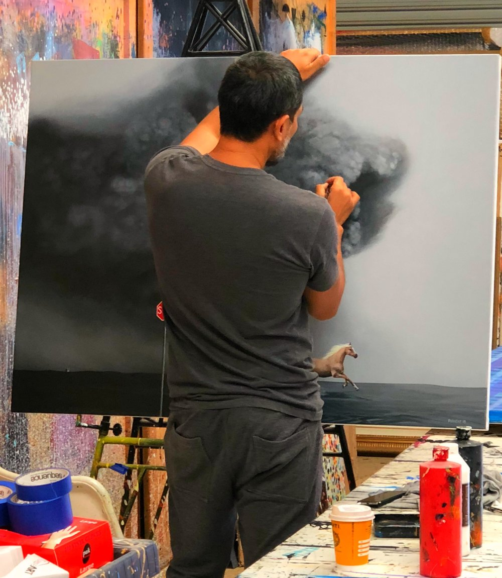 Above: Hyper-realism artist, Phonsay painting in his Albury-based studio.
