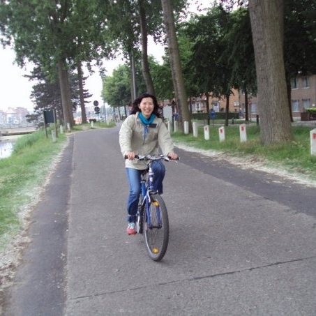 Mandy rides in Bruges, Belgium. on rented bikes and rode this trail to the Netherlands
