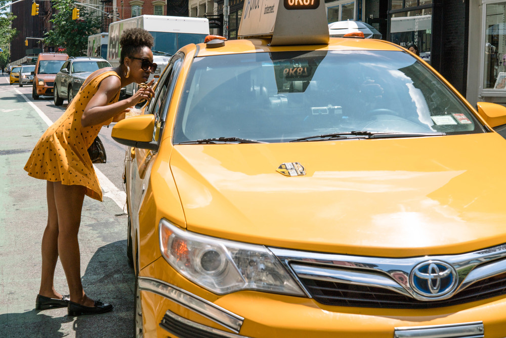Yellow dress and yellow cab. Same yellow. Enough said!