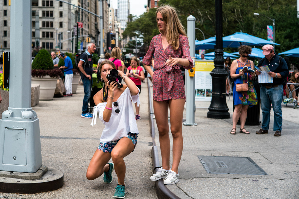 I shot this image because it was just the cutest thing to see - visitors taking picture of the Flat Iron Building, on a cropped sensor Nikon. Love the photography theme in the image.