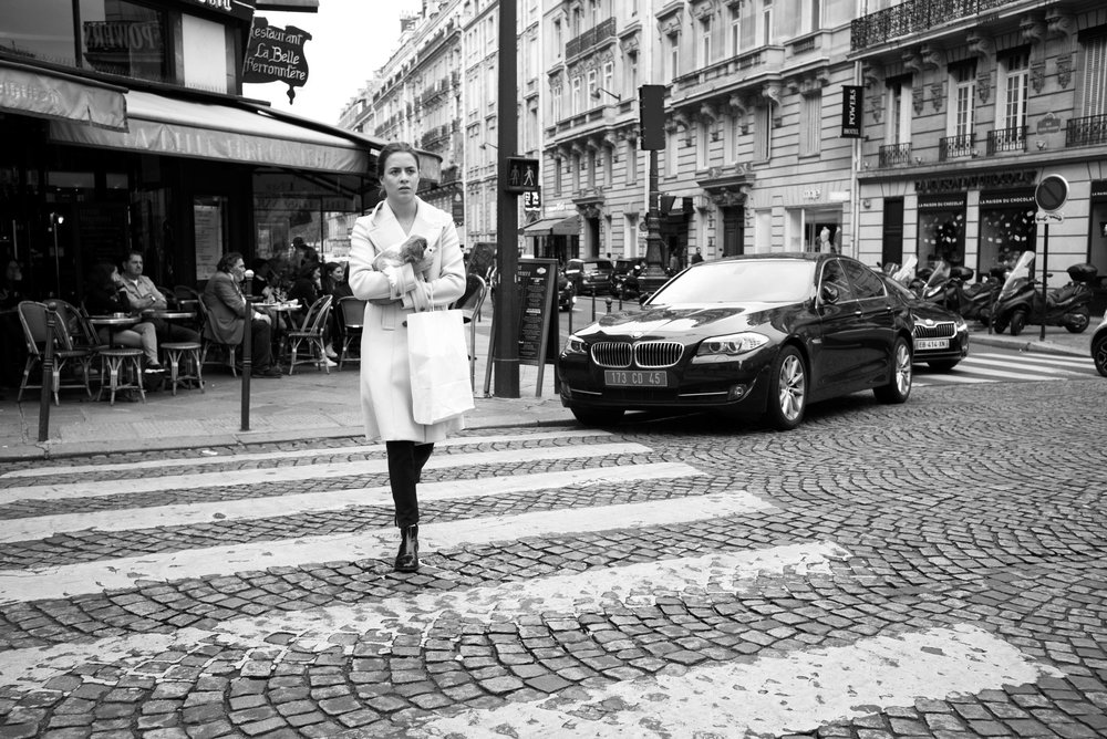 A woman walking across the zebra crossing on a typical cobblestone street. At the time I thought that this was a very Parisian street scene - which it is - and which is why it's unoriginal.