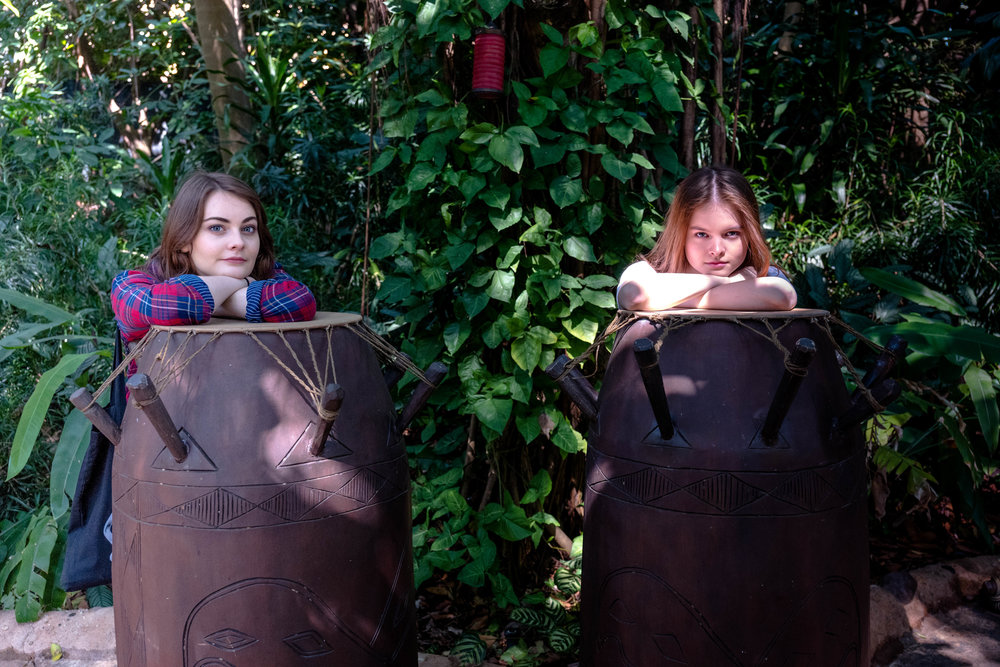 On tribal drums. This image has gone through considerable post, in editing. In the original capture, Anna's face was in shadow, while Lessy's face was in extreme highlight. As a result, there wasn't much contrast in either Anna or Lessy's face, making focus selection difficult in auto mode.