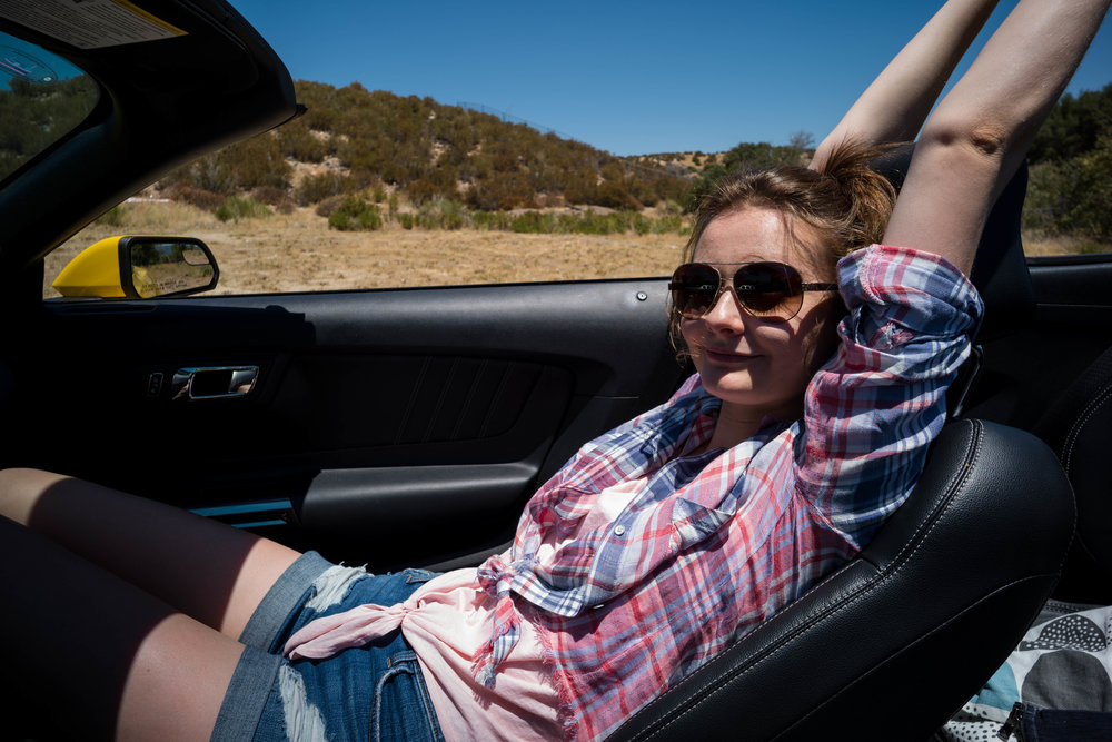 Reclining with the top down. With some distortion on Anna's left arm. Leica 21mm f/3.4 Super Elmar ASPH