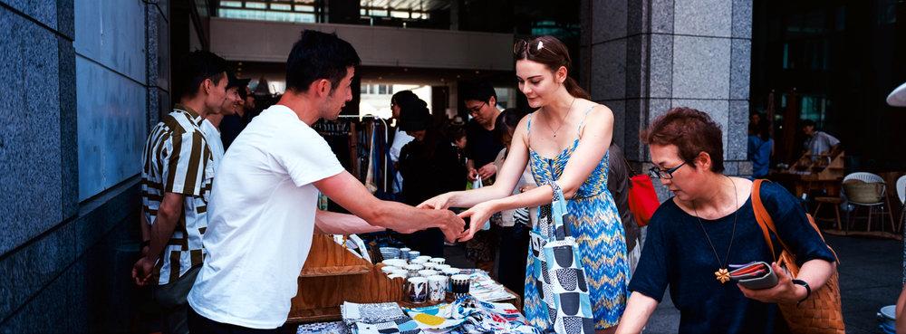 Buying her bag, at a UN School Flea Market - Kodak Ektar 100