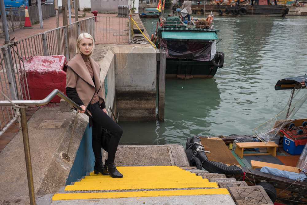 On the steps by a sampan ferry.