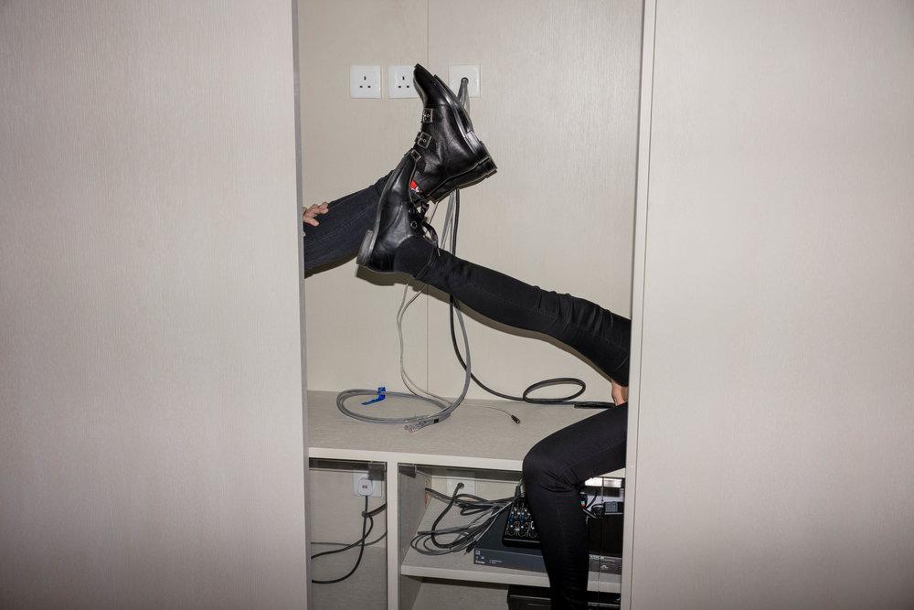 Hidden and kicking their heels.