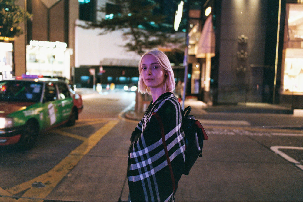 Nikon F6 + Nikon AF-S 28mm f/1.4E + Fujifilm Superia Venus 800 - The magenta colorization in the skin tone is a result of the LED signage across the street.