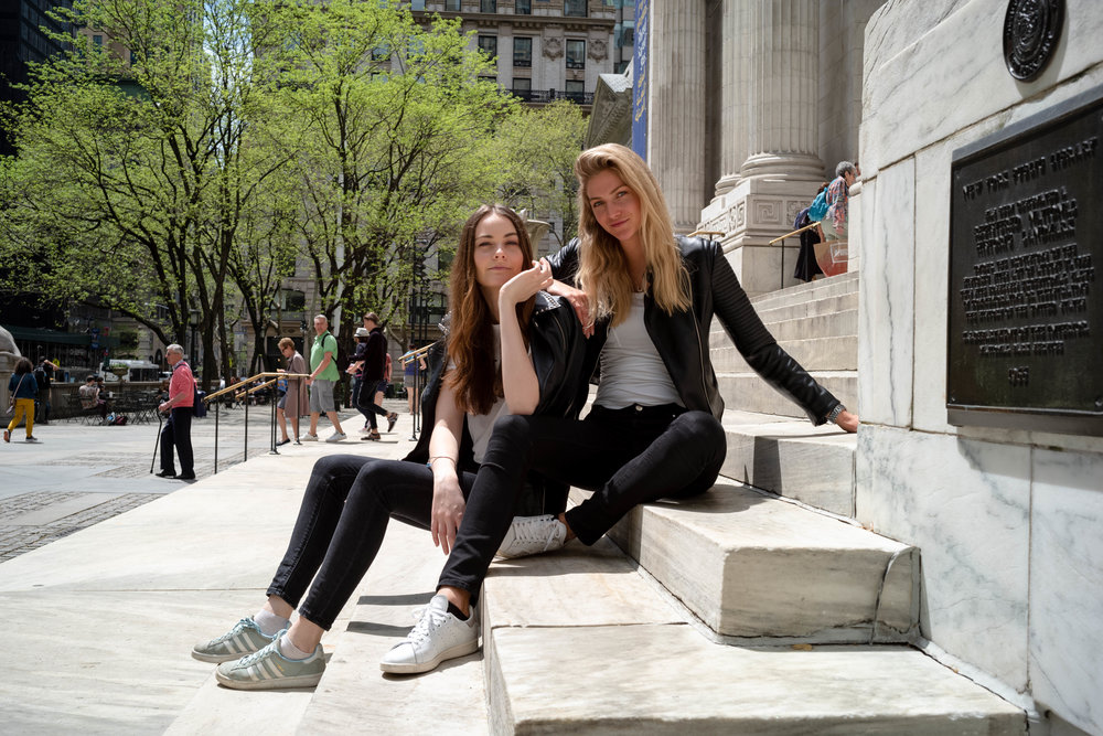 On the steps of the New York Public Library.