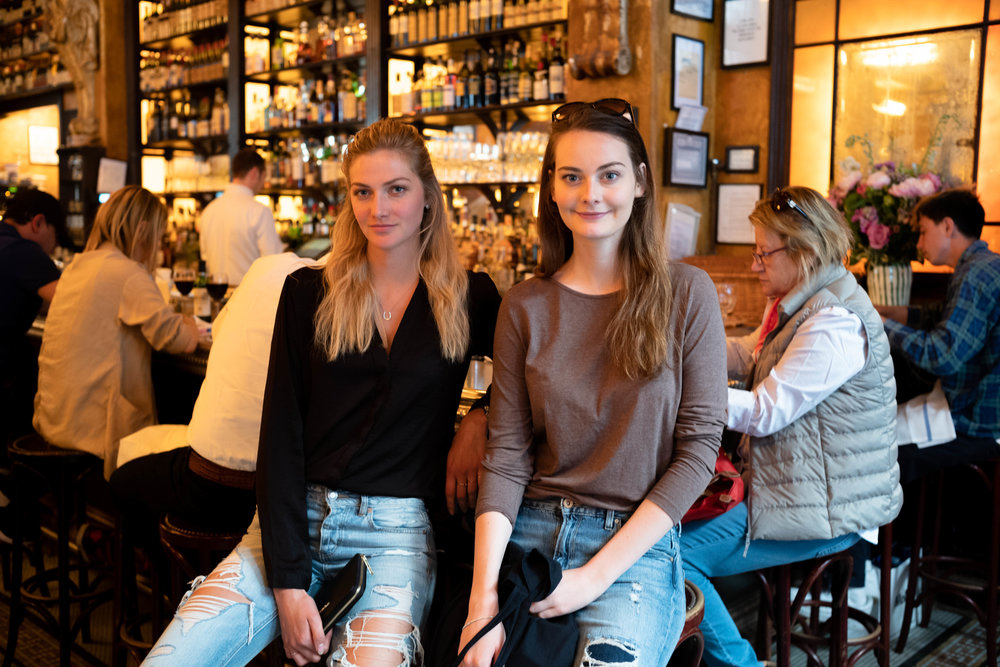 Leica M10 + 35mm f/1.4 Summilux AA - An easy photo of Lydia and Anna seated by the bar. The people in the background are not obtrusive, since they are evenly distributed while providing environmental context.