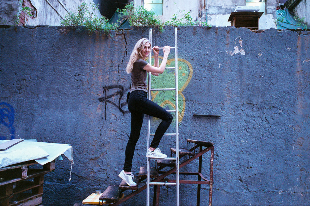Fujifilm Superia Venus 800 @ 35mm Focal Length - Interacting with the environment by climbing up a ladder. Compositional variables include texture and color on the wall.