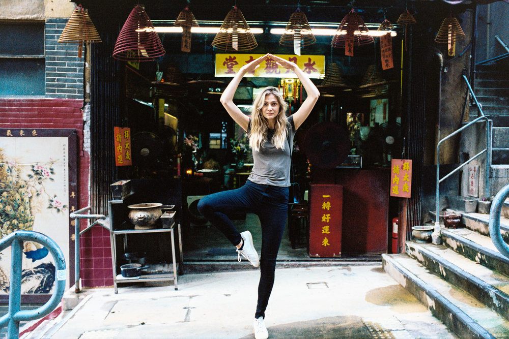 Kodak Portra 400 @ 35mm Focal Length - Doing a tree pose. Compositional variables include clutter from the background shop.