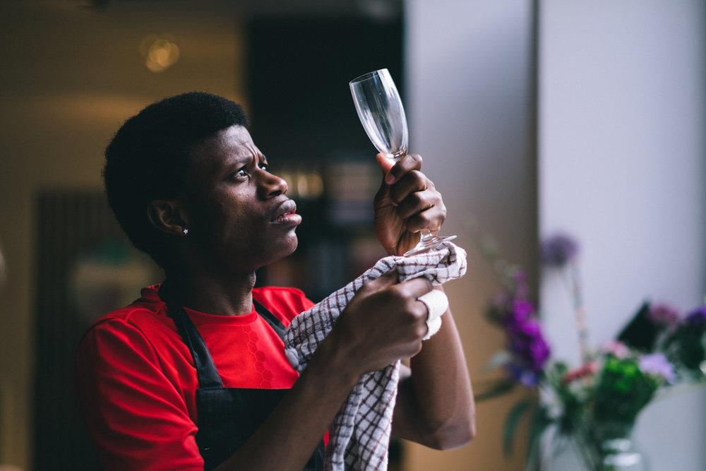 Emmanuel with a glass at Fat Macys Supper Club