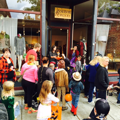 Reservoir & Wood handing out candy to kids during Beacon's Hocus Pocus Parade.