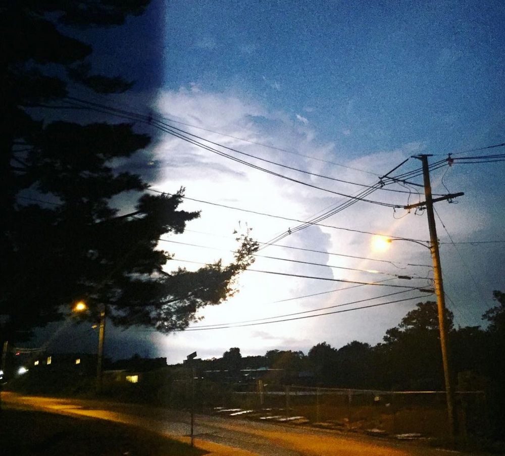 Lightning striking and brightening the sky with white. Photo Credit: Marjorie Tarter @majolie126