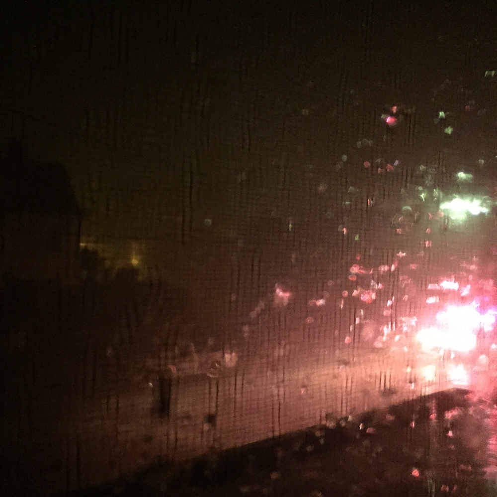 Watching First Responders drive down the street during the thunder and lightning storm. Photo Credit: Katie Hellmuth Martin