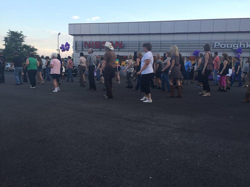 Poughkeepsie Nissan is known for their BIG Lot of new and used cars of many makes and models, but this night, the lot is turned into an outdoor dance floor. Photo Credit: Allie Bopp, A Little Beacon Blog